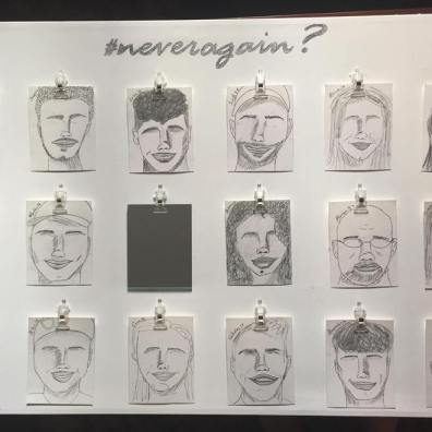 """""""I was inspired to create this work out of frustration and fear that the shooting-related deaths in schools will not end. Depicted, are facial representations drawn in tribute to the """"Parkland 17,"""" who are rendered without eyes to bring attention to the blindness of our political system when it comes to gun-control legislation. The 18th spot is occupied by a mirror. Who will be the next victim? Look in the mirror. Will it be you?"""""""